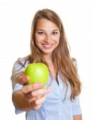 Beautiful woman offers an apple