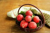 stock photo of radish  - juicy ripe radish on a wooden table