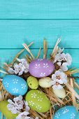 Easter composition with flowering branches on wooden table close-up