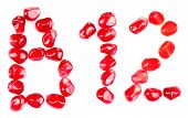 Vitamin B12 sign made of pomegranate seeds, isolated on white