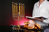Festive ceremony on Hanukkah on dark background
