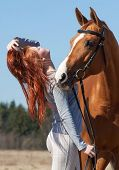 foto of horses ass  - Beautiful red haired girl and red horse - JPG