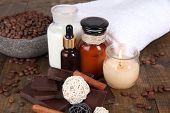 Beautiful chocolate spa setting on wooden table close-up