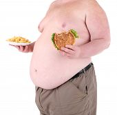 Fat man holding sandwich and fried potato, isolated on white