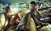 stock photo of woman glamorous  - Sexy couple in the car - JPG