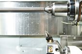 industrial metal work machining process by cutting tool on automated lathe