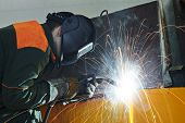 stock photo of tig  - welder working with electrode at semi - JPG