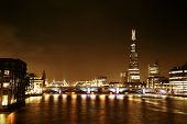 Southwark Bridge and London skyline at night.