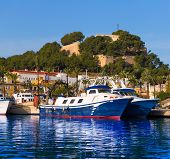 Denia Port with castle hill fisherboats in Alicante province Spain