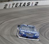 Fort Worth, TX - Apr 03, 2014:  Elliot Sadler (11) brings his race car through the turns during the
