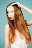 Portrait of a beautiful tender girl with magnificent long hair. Hairstyle, hair care.