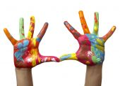 foto of child development  - close up of child hands painted with watercolors on white background with clipping path - JPG