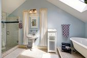 picture of bath tub  - Light blue velux bathroom with window - JPG