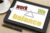 work life balance concept on a digital tablet with a cup of coffee