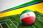 Soccer Ball With Iran Flag On Pitch