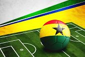 Soccer Ball With Ghana Flag On Pitch