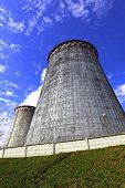 pic of chp  - Large factory chimneys on blue sky background - JPG