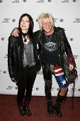 NEW YORK-APR 17: Heart and Jimmy Webb (R) attend the 'Super Duper Alice Cooper' premiere during the