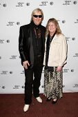 NEW YORK-APR 17: Musician Neal Smith (L) and Rose Smith attend the 'Super Duper Alice Cooper' premie