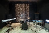 stock photo of drum-kit  - Studio room with musical instruments and record equipment - JPG
