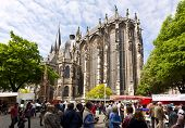 Aachen, Germany - May 5, 2009: Farmers market in front of Aachen cathedral, UNESCO world heritage si