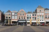 Townscape With People Sitting On Terraces Of Delft, The Netherlands