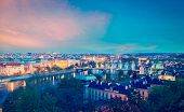 Vintage retro hipster style travel image of travel Prague concept background - elevated view of bridges over Vltava river from Letn�?�?�?�¡ Park. Prague, Czech Republic in twilight