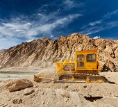 Bulldozer doing road construction in Himalayas. Ladakh, Jammu and Kashmir, India
