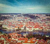 Vintage retro hipster style travel image of aerial view of Charles Bridge over Vltava river and Old