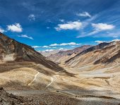 Himalayan valley landscape with road near Kunzum La pass - allegedly the highest motorable pass in t