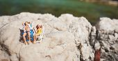 Miniature couple an a beach in swimming costume