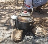Kettle On Camp Fire In Desert