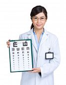 Optician woman showing eye exam chart