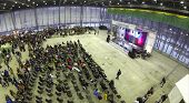RUSSIA, MSCOW - JAN 25, 2014: Aerial view to people sitting in chairs in front of stage at largest E