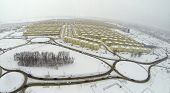 RUSSIA, SAMARA - JAN 5, 2014: Aerial view to Koshelev project with identical houses near superstore