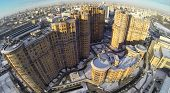 RUSSIA, MOSCOW - JAN 20, 2014: Aerial view to high-rise residential buildings at Cascade housing complex in winter.