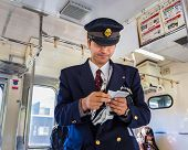 Japanese Train Conductor