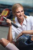 image of karts  - Girl  with helmet and screwdriver in Karting - JPG