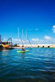 Woman Floats In A Canoe