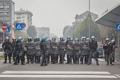 Riot Police Watches The Students Protesting In Milan, Italy