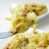 closeup of a plate with sauteed cabbage with bacon
