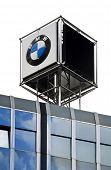 Dusseldorf, Germany -  July 24th, 2009: BMW sign on car dealers office building roof.