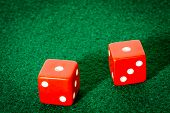 Red Dice on poker table