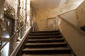 Old Staircase In An Abandoned And Ruined House