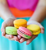 Girl Holding Colorful Macaroons In Hands