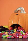 Happy Halloween Jack-o-lantern Pumpkin With Colorful Trick Or Treat Candy Jellies, Orange Chocolates