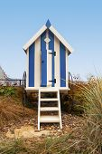 Portrait Format Blue Striped Beach Hut With Steps, Filey, Uk