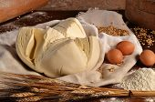 Fresh dough and ingredients on wooden table