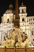Beautiful Fountain of the Four Rivers by night on Piazza Navona in Rome, Italy