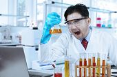 Ridiculous Scientist With Chemistry Liquid